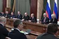 Russian President Vladimir Putin, center right, and new Russian Prime Minister Mikhail Mishustin, center left, attend a new cabinet meeting in Moscow, Russia, on Jan. 21, 2020. (Alexei Nikolsky, Sputnik, Kremlin Pool Photo via AP)