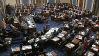 In this image from video, Senators vote on approving the rules for the impeachment trial against U.S. President Donald Trump in the Senate at the Capitol in Washington, on Jan. 22, 2020. (Senate Television via AP)
