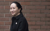 Meng Wanzhou, chief financial officer of Huawei, leaves her home to go to B.C. Supreme Court in Vancouver, on January 22, 2020. (Jonathan Hayward/The Canadian Press via AP)