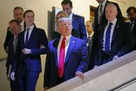 U.S. President Donald Trump, center, leave the World Economic Forum in Davos, Switzerland, on Jan. 21, 2020. (AP Photo/Markus Schreiber)