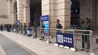 In this image made from video, Chinese paramilitary police stand guard outside the closed Hankou Railway Station in Wuhan in central China's Hubei Province, on Jan. 23, 2020. (The Paper via AP)