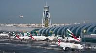 In this Dec. 11, 2019, file photo, an Emirates jetliner comes in for landing at Dubai International Airport in Dubai, United Arab Emirates. (AP Photo/Jon Gambrell)