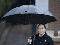 Meng Wanzhou, chief financial officer of Huawei, leaves her home to go to B.C. Supreme Court in Vancouver, on January, 23, 2020. (Jonathan Hayward/The Canadian Press via AP)