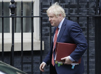 Britain's Prime Minister Boris Johnson leaves 10 Downing Street to attend the weekley session of Prime Ministers Questions in Parliament in London, on Jan. 22, 2020. (AP Photo/Kirsty Wigglesworth)