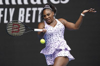 Serena Williams of the U.S. makes a forehand return to China's Wang Qiang in their third-round match at the Australian Open tennis championship in Melbourne, Australia, on Jan. 24, 2020. (AP Photo/Lee Jin-man)