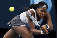 Coco Gauff of the U.S. makes a backhand return to Japan's Naomi Osaka during their third-round singles match at the Australian Open tennis championship in Melbourne, Australia, on Jan. 24, 2020. (AP Photo/Lee Jin-man)