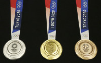 In this July 24, 2019 file photo, Tokyo 2020 Olympic medals are unveiled during a One Year to Go Olympic ceremony event in Tokyo. (AP Photo/Koji Sasahara)