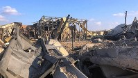 U.S. soldiers and journalists inspect the rubble at a site struck in an Iranian missile attack, at Ain al-Asad air base in Anbar province, Iraq, on Jan. 13, 2020. (AP Photo/Qassim Abdul-Zahra)