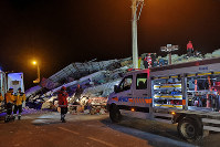 Rescue workers search a collapsed building after a strong earthquake struck Sivrice town in Elazig province, eastern Turkey, on Jan. 24, 2020. (DHA via AP)