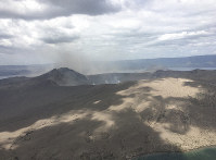 In this Jan. 21, 2020, photo provided by the Philippines Office of Civil Defense, Taal volcano emits small amounts of ash in Batangas province, southern Philippines. The Philippine government will no longer allow people to live on the crater-studded island that's home to the volcano. (Philippines Office of Civil Defense via AP)