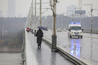 An ambulance drives across a bridge in Wuhan in central China's Hubei province, on Jan. 25, 2020. (Chinatopix via AP)