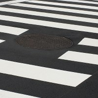 This file photo taken on Jan. 27, 2020 shows a manhole on a pedestrian crossing in Tokyo's Chiyoda Ward. (Mainichi)