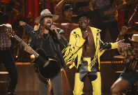 This June 23, 2019 file photo shows Billy Ray Cyrus, left, and Lil Nas X performing