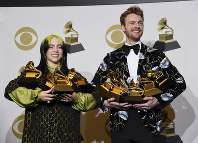 Billie Eilish, left, and Finneas O'Connell pose in the press room with the awards for best album, best engineered album and best pop vocal album for