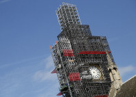 In this April 17, 2018 file photo, scaffolding surrounds the Queen Elizabeth Tower, which holds the bell known as Big Ben, in London. (AP Photo/Alastair Grant, file)