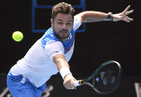 Switzerland's Stan Wawrinka makes a backhand return to Russia's Daniil Medvedev during their fourth-round singles match at the Australian Open tennis championship in Melbourne, Australia, on Jan. 27, 2020. (AP Photo/Andy Brownbill)