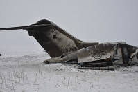 A wreckage of a U.S. military aircraft that crashed in Ghazni province, Afghanistan, is seen on Jan. 27, 2020. (AP Photo/Saifullah Maftoon)