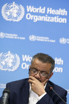 Director General of the World Health Organization, WHO, Tedros Adhanom Ghebreyesus, leads a press conference after an Emergency Committee meeting on what scientists have identified as a new coronavirus, at the World Health Organization (WHO) headquarters in Geneva, Switzerland, on Jan. 22, 2020. (Salvatore Di Nolfi/Keystone via AP)