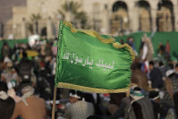 In this Nov. 9, 2019 file photo, a supporter of Shiite rebels, known as Houthis, holds a banner with Arabic writing that reads,