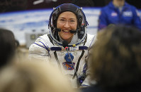 In this March 14, 2019 file photo, U.S. astronaut Christina Koch, member of the main crew of the expedition to the International Space Station (ISS), speaks with her relatives through a safety glass prior the launch of Soyuz MS-12 space ship at the Russian leased Baikonur cosmodrome, Kazakhstan. (AP Photo/Dmitri Lovetsky, Pool)