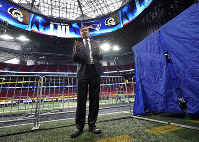 In this Jan. 29, 2019 file photo, NFL Chief Medical Officer Dr. Allen Sills explains what takes place inside a sideline injury tent, right, during a health and safety tour at Mercedes-Benz Stadium for the NFL Super Bowl 53 football game in Atlanta. (AP Photo/David J. Phillip)