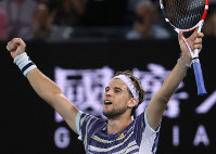 Austria's Dominic Thiem celebrates after defeating Spain's Rafael Nadal in their quarterfinal match at the Australian Open tennis championship in Melbourne, Australia, on Jan. 29, 2020. (AP Photo/Andy Wong)