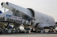 A pair of 787 Dreamliner wings are seen being carefully loaded onto a Boeing Dreamlifter cargo plane on Feb. 12, 2020, at Central Japan International Airport in Tokoname, Aichi Prefecture. (Mainichi/Koji Hyodo)
