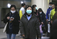 People in Taiwan wear protective face masks at a metro station in Taipei, Taiwan, on Feb. 9, 2020. (AP Photo/Chiang Ying-ying)