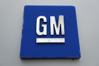 This Jan. 27, 2020, file photo shows a General Motors logo at the General Motors Detroit-Hamtramck Assembly plant in Hamtramck, Mich.  (AP Photo/Paul Sancya)