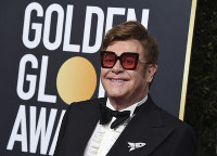In this Jan. 5, 2020 file photo, Elton John arrives at the 77th annual Golden Globe Awards at the Beverly Hilton Hotel, in Beverly Hills, Calif. (Photo by Jordan Strauss/Invision/AP)