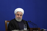 Iran's President Hassan Rouhani gives a press conference in Tehran, Iran, on Feb. 16, 2020. (AP Photo/Ebrahim Noroozi)