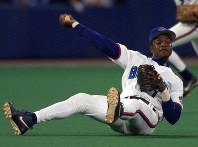 In this Sept. 17, 1999, file photo, Toronto Blue Jays third baseman Tony Fernandez throws to first as he tumbles to the turf during third-inning AL action against the Chicago White Sox in Toronto. (Frank Gunn/The Canadian Press via AP)