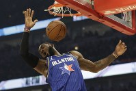 LeBron James of the Los Angeles Lakers dunks during the first half of the NBA All-Star basketball game on Feb. 16, 2020, in Chicago. (AP Photo/Nam Huh)