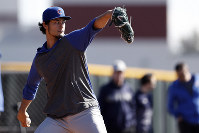 Chicago Cubs pitcher Yu Darvish throws during a spring training baseball workout, on Feb. 12, 2020, in Mesa, Ariz. (AP Photo/Gregory Bull)