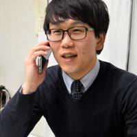 「自分の力で立ち上がれるように応援するだけ」と話す西川善道さん=天理市で、廣瀬晃子撮影