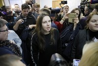 Alla Ilyina, who broke out of the hospital on Feb. 7 after learning that she would have to spend 14 days in isolation instead of the 24 hours doctors promised her, speaks to the Media in a courtroom in St.Petersburg, Russia, on Feb. 17, 2020. (AP Photo/Dmitri Lovetsky)