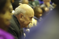 In this Feb. 13, 2020 file photo, former South African President FW de Klerk waits for President Cyril Ramaphosa to deliver his State of the Nation Address in Cape Town, South Africa. (Sumaya Hisham /Pool Photo via AP)