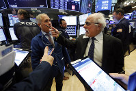 Traders Timothy Nick, left, and Peter Tuchman work on the floor of the New York Stock Exchange, on  Feb. 18, 2020.  (AP Photo/Richard Drew)