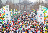 Runners are seen reaching the finish line at the 2019 Tokyo Marathon, in the capital's Chiyoda Ward on March 3, 2019. (Pool photo)