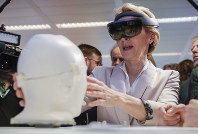 President of the European Commission Ursula von der Leyen looks at the invention 'Sara' at the AI Xperience Center at the VUB (Vrije Universiteit Brussel) in Brussels, on Feb. 18. 2020. (Stephanie Lecocq, Pool Photo via AP)