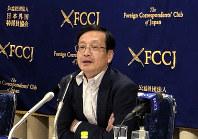 Hitoshi Oshitani, Professor of Department of Virology, Tohoku University Graduate School of Medicine, speaks during a press conference in Tokyo, on Feb. 19, 2020. (AP Photo/Stephen Wade)