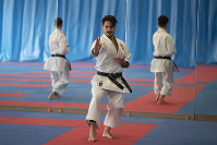 Spanish karate athlete Damian Quintero, center, trains in Madrid, Spain, on Feb. 7, 2020. (AP Photo/Paul White)