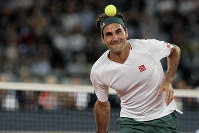 Roger Federer in action during the exhibition tennis match against Rafael Nadal held at the Cape Town Stadium in Cape Town, South Africa, on Feb. 7, 2020. (AP Photo/Halden Krog)