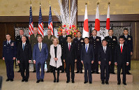 Former U.S. President Dwight Eisenhower's granddaughter Mary Eisenhower, fourth from left in the front row; his great grandson Merrill Eisenhower Atwater, third from left in the front row; and Japanese Prime Minister Shinzo Abe, fourth from right in the front row, are pictured with other officials from Japan and the United States during a reception to celebrate the 60th anniversary of the signing of the Japan-U.S. security treaty, at the Iikura Guesthouse in Tokyo, on Jan. 19, 2020. (Mainichi/Toshiki Miyama)