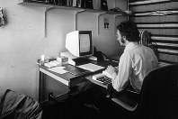In this 1970s photo provided by Xerox PARC, Larry Tesler uses the Xerox Parc Alto early personal computer system. (Xerox PARC via AP)