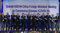 Chinese Foreign Minister Wang Yi, sixth from left, poses for a group photo ahead of the Special ASEAN-China Foreign Ministers' meeting on the Novel Coronavirus Pneumonia in Vientiane, Laos, on Feb. 20, 2020. (AP Photo/Sakchai Lalit)
