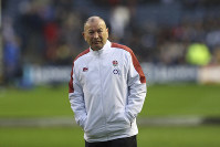 England head coach Eddie Jones stands with his hands in his pockets before the Six Nations rugby union international match between Scotland and England at Murrayfield Stadium, in Edinburgh, Scotland, on Feb. 8, 2020. (AP Photo/Scott Heppell)