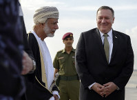 U.S. Secretary of State Mike Pompeo is greeted by Oman's Minister of Foreign Affairs Yusuf bin Alawi bin Abdullah, left, upon his arrival in the Oman capital of Muscat, on Feb. 21, 2020. (Andrew Caballero-Reynolds/Pool via AP)