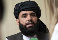 In this May 28, 2019 file photo, Suhail Shaheen, spokesman for the Taliban's political office in Doha, speaks to the media in Moscow, Russia. (AP Photo/Alexander Zemlianichenko)