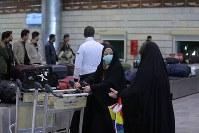Women wearing masks arrives from Iran in Najaf, Iraq, on Feb. 21, 2020. (AP Photo/Anmar Khalil)